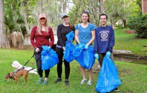 volunteers with garbage bags at park